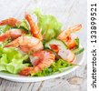 Green salad with shrimps - stock photo