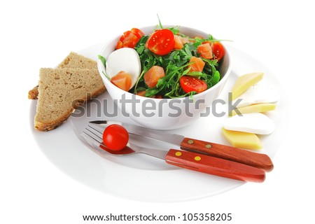 green salad with smoked salmon and bread in white bowl - stock photo