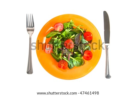 green salad with the knife and a fork
