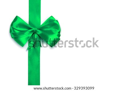 green satin ribbon with bow isolated over white background