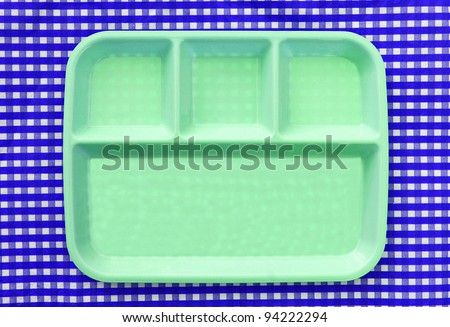 Green School Lunch Serving Tray / Plate isolated on blue and white checkered background - stock photo