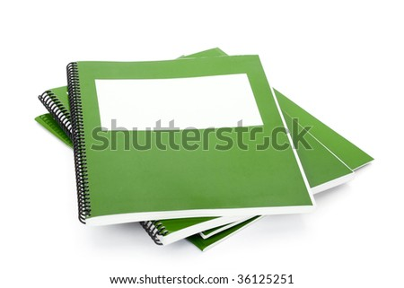 Green school textbook, notebook or manual with white background - stock photo