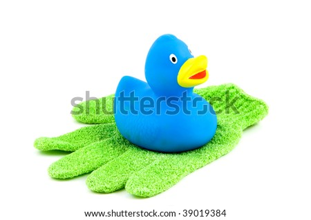 Green scrub glove with blue rubber duck isolated on white background