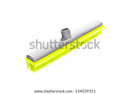Green scrubbing broom on white background - stock photo