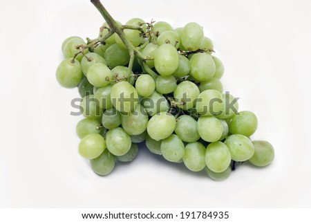 Green seedless grapes against a white background. - stock photo