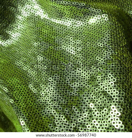 Green sequined texture closeup. More of this motif & more textiles in my port. - stock photo