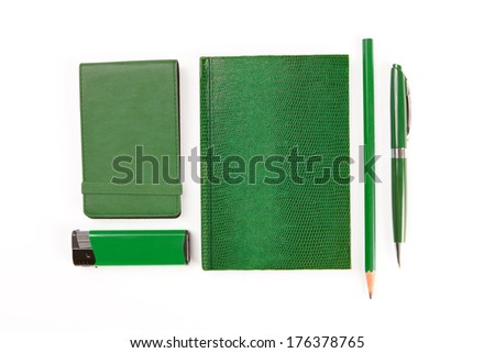 Green set of stationery isolated on white background  - stock photo