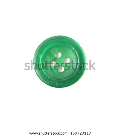 Green sewing button isolated on white