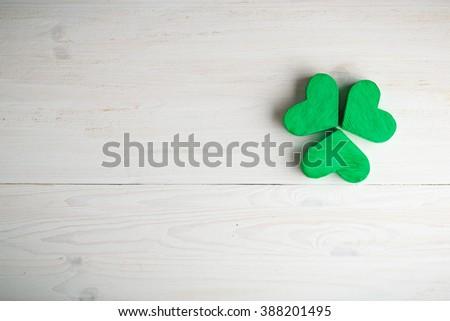Green shamrock clovers on white wooden background . Background for St. Patrick's Day celebration - stock photo