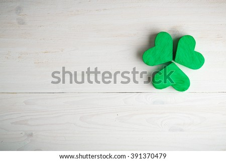 Green shamrock clovers on white wooden background. Background for St. Patrick's Day celebration - stock photo