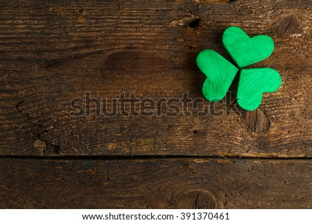 Green shamrock clovers on wooden background. Background for St. Patrick's Day celebration - stock photo