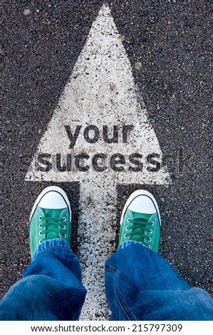 Green shoes standing on your success sign - stock photo