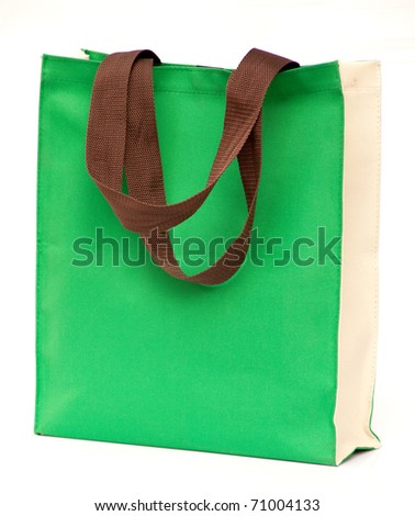 green shopping bag on white isolated background.