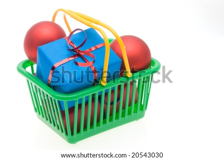 green shopping basket full of Christmas gifts