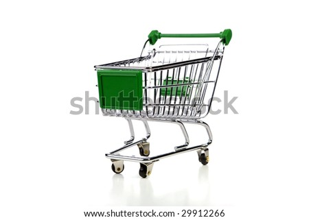 green shopping cart over white background - stock photo