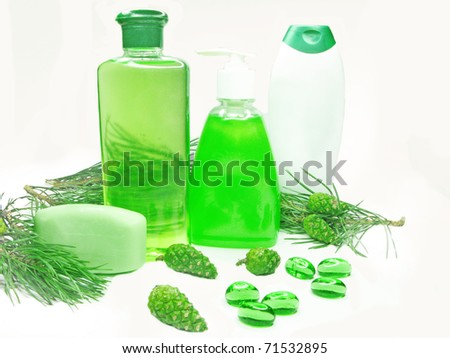 green shower gel bottles with fir natural coniferous extract - stock photo