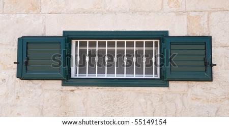 Green shutter. - stock photo