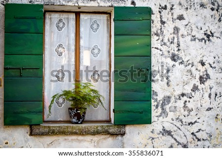 Green shutter and white wall - stock photo
