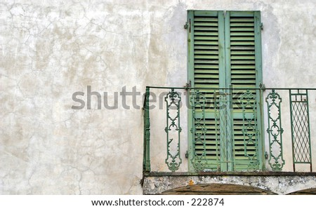 Green shutter doors and a balcony - stock photo
