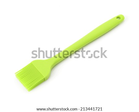 Green Silicon kitchen brush isolated on white background - stock photo