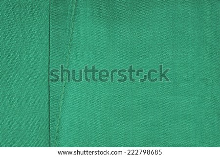 Green silk fabric macro shot for background