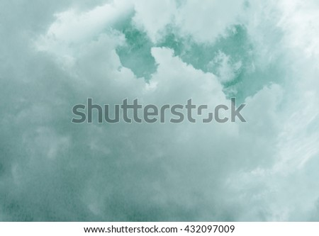 Green sky with cloud / green sky background with tiny clouds / soft white clouds against green sky / white fluffy clouds in the blue sky / Sky daylight. Natural sky composition. Element of design. - stock photo