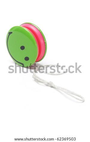 Green smiley yo yo on white background - stock photo