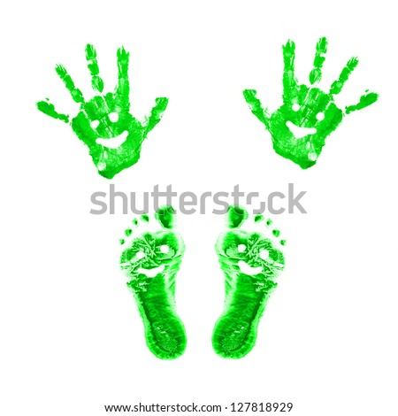 Green smiling prints of children's painted hands and feet. Conceptual symbol of eco-friendly person. Isolated on white background. - stock photo