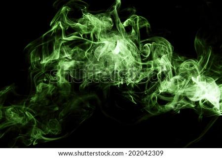 Green smoke on black background. - stock photo