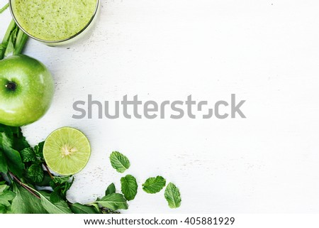 Green smoothie and ingredients on the white background. Diet concept with text space - stock photo