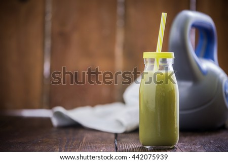 green smoothie drink after gym exercise, healthy lifestyle concept - stock photo