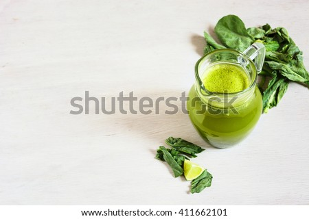 Green smoothie in the jar on the white rustic table. Diet concept. Vegetarian food. Diet concept. Vegetarian food - stock photo