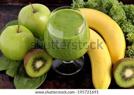 Green smoothie made with spinach, kale, kiwi, green apples and bananas - stock photo
