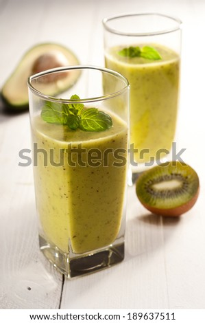 Green smoothie with avocado, kiwi, cucumber and mint - stock photo