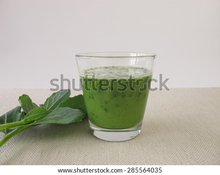 Green smoothie with german turnip leaves - stock photo