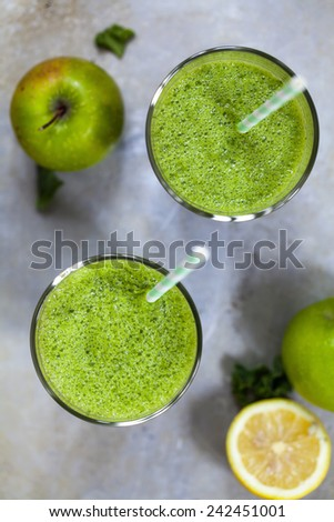 Green smoothie with kale, apples and banana - stock photo