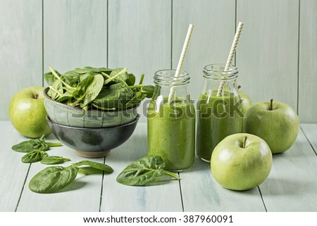 Green smoothie with spinach and apples in glass - stock photo