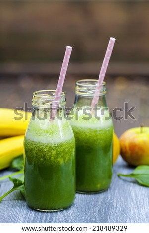 Green smoothies with spinach, apples and bananas - stock photo