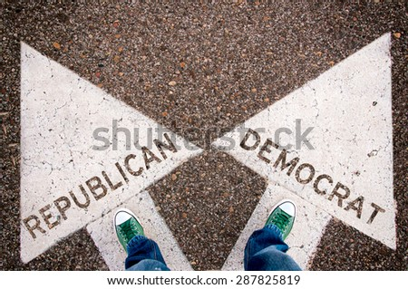 Green sneackers from above on the white arrows with Republican and Democrat sign - stock photo