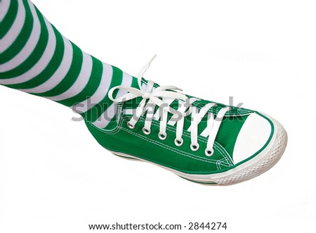 green sneakers and matching green socks for st patricks day - stock photo