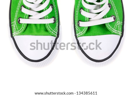 green sneakers  isolated on white background - stock photo
