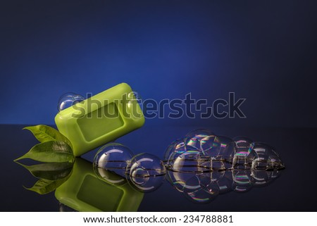 green soap bubbles on a blue background - stock photo