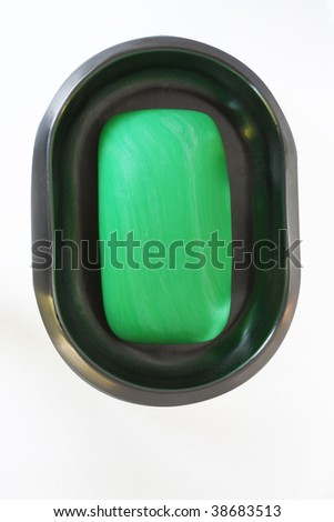 Green soap in soap dish - stock photo