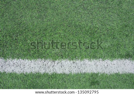 green soccer field with white stripe background - stock photo