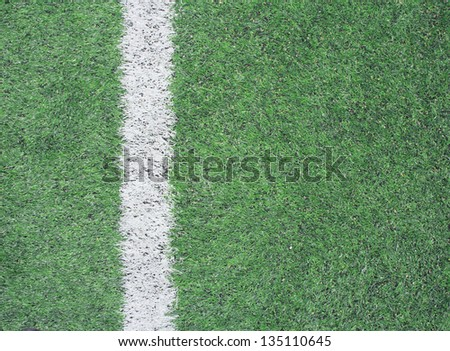 green soccer field with white stripe background