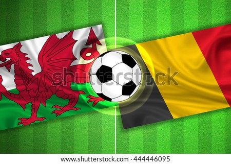 green Soccer / Football field with stripes and flags of wales - belgium, and ball.