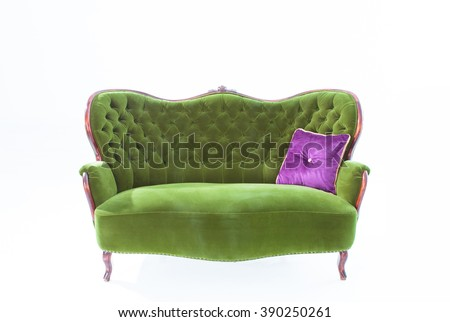 Green sofa and pillow purple on white background. - stock photo