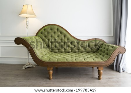 Green sofa with luxurious look - stock photo