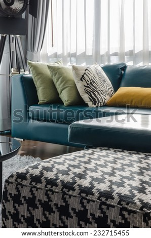 green sofa with pillow in modern living room at home - stock photo