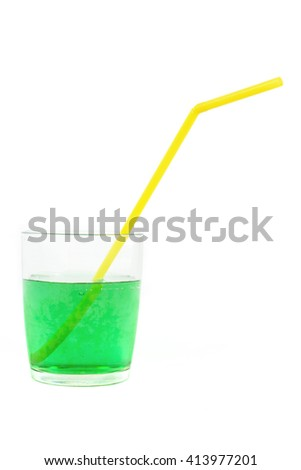 green soft drink, glass and yellow straw, isolated, white background